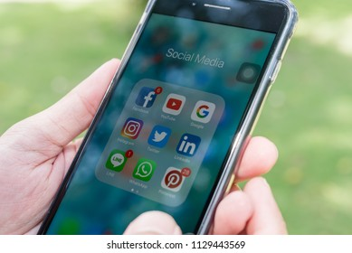 BANGKOK, THAILAND- 02 July 2018 :Hands of man use Iphone with applications of social media