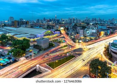 BANGKOK, THAILAND 03 January 2019 : View of a long exposure traffic at junction in front of Bangkok Trainstation (hualumphong) at night