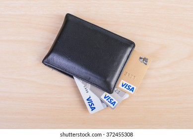 Bangkok, thailand - 04 FEBRUARY 2016: Visa credit cards on leather board.