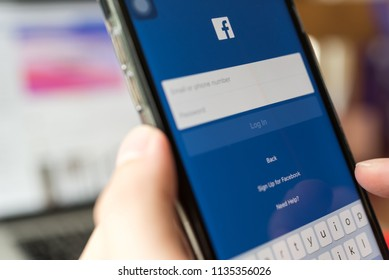BANGKOK, THAILAND- 06 July 2018 : Hands of man use Facebook application log in screen on mobile phone