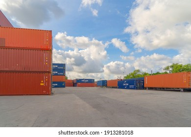 Bangkok, Thailand - 08 01 2021 : Shipping container site loading by crane in logistic port warehouse storage factory manufacturing business transportation import and export goods of freight carrier.
