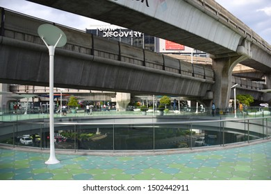 Bangkok, Thailand, 08.24.2019: Siam Square overpass with BTS SkyTrain concrete railroads and Siam Discovery shopping mall in the background