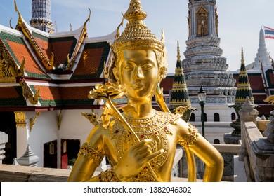 Bangkok. Thailand. 09/12/2018. Wat Phra Kaeo complex, King's palace. Kinnari, Kinnorn or Kinnare statue, mythical creature. Golden statue