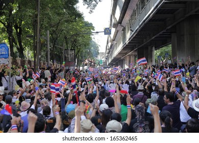 BANGKOK, THAILAND: 1 DECEMBER: Protesters join and blow whistles to support anti-government protest on December 1, 2013 on the road in front of Royal Thai Police Headquarters.