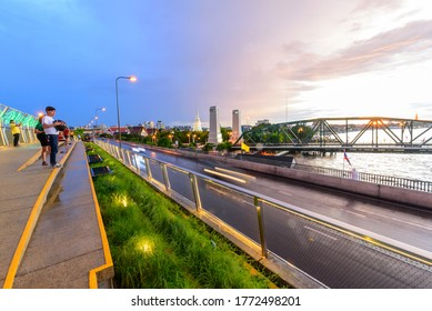 Bangkok , Thailand - 1 July, 2020: People walking and sitting in relax at Chao Phraya Sky Park  landmark in Bangkok