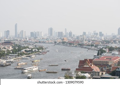 Bangkok, Thailand - 10 Feb, 2019 : Aerial view of Bangkok city. Cityscape at Chaopraya river near Grand Palace in Bangkok metropolis , Thailand. Skycrapers are covered with PM 2.5 dust.