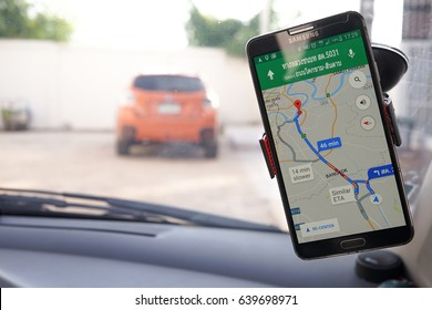 BANGKOK, THAILAND - 10 MAY 2017: Close up of  Samsung smartphone and using application Google Maps to destination. navigation service by Google company on car holder