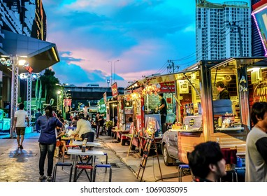 BANGKOK, THAILAND - 10 November, 2017: People joined foodtruck event in the night, happy to buying food, meeting friends, waiting and eating dinner from foodtruck shop. This event near to RCA.