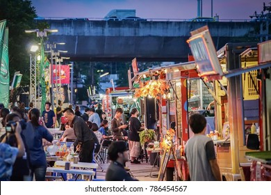 BANGKOK, THAILAND - 10 November, 2017: People joined foodtruck event in the night, happy to buying food, meeting friends, waiting and eating dinner from foodtruck shop. This event near to RCA. (Royal