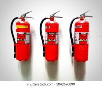 bangkok thailand 10/03/2018.3 tank fire extinguishers Red hanging on a white wall.