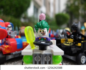 Bangkok, Thailand - 11 Dec 2018: Lego Mighty Micro Joker minifigure driving his car among his friends