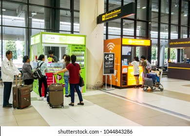 Bangkok, Thailand 11 February 2018 : Tourists are asking price and how to use rental wifi and mobile phone sim card for tourist at booths stand in Don Mueang International Airport.