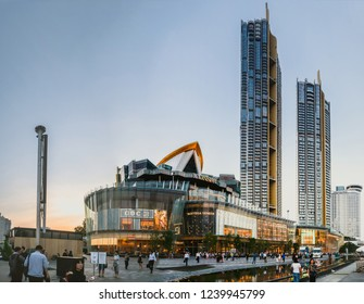 BANGKOK, THAILAND - 12 Nov, 2018: Exterior view of ICON Siam at River side. ICON SIAM is the new Shopping Center and Landmark of Bangkok at evening with motion blur of many tourist in front.
