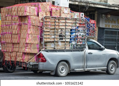 Bangkok, Thailand, 12.13.2017: Overloaded pickup, car with an excessive freight, load.