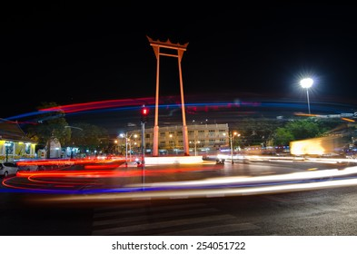 BANGKOK, THAILAND - 14 February, 2015 : The Giant Swing or Sao Chingcha in front of Wat Suthat temple at night. It is a famous landmark for traveling in Bangkok, Thailand