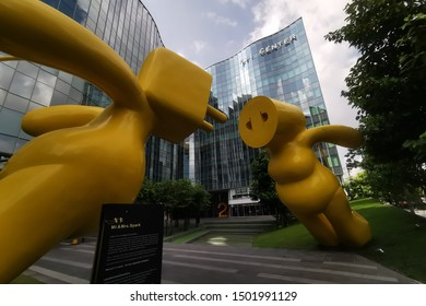 Bangkok Thailand : 14 July 2019 - Yellow Plug Man and Plug Woman in front of the FYI Center Building