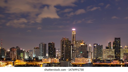 Bangkok, Thailand - 14 Juny 2019: Panoramic landscape scenery of buildings and skycrapers in the central business area of Bangkok city at night