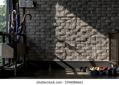 Bangkok, Thailand - 15 Dec 2019 : The sunlight shines on the Umbrella Stand Box and Shoe Holder in loft style home, Selective focus.