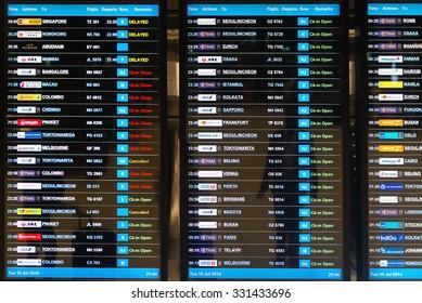 BANGKOK, THAILAND - 15 JULY 2014: Digital schedule board announcing flight departures at Suvarnabhumi Airport in Bangkok, Thailand.