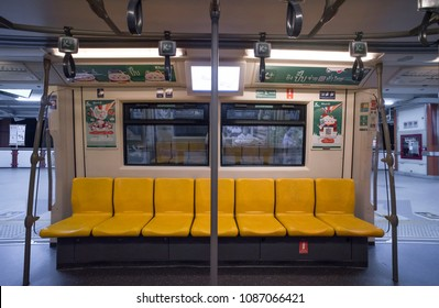 BANGKOK, THAILAND - 15 March 2018: Inside BTS Sky train with yellow chairs no passenger