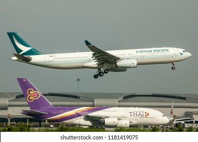 Bangkok Thailand 15 Sep 2018: FedEx Cargo Boeing 767 was landing to Suwannabhum airport when Thai Airways Airbus A380-841 HS-TUC was testing engine in high performance.