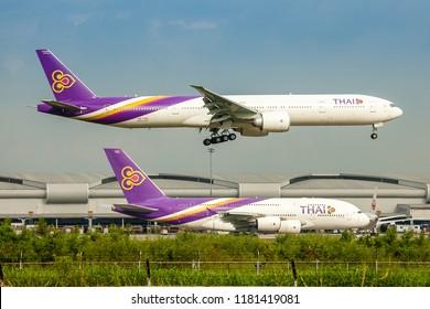 Bangkok Thailand 15 Sep 2018: Thai airways Boeing 777-300ER was landing to Suwannabhum airport when Thai Airways Airbus A380-841 HS-TUC was testing engine in high performance.