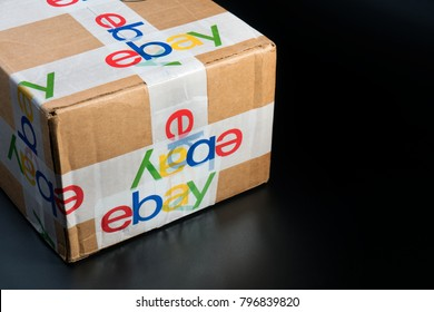 Bangkok, Thailand 16, 2018: Brown paper box eBay packaging with security scotch tape delivered from international shipping.