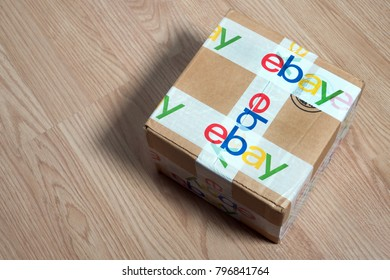 Bangkok, Thailand 16, 2018: Brown paper box ebay packaging with security scotch tape delivered from international shipping on wooden table.