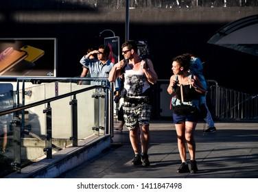 BANGKOK, THAILAND - 16 DEC : Tourist with travel bag walking at overpass on 16 December 2018 in Bangkok, Thailand
