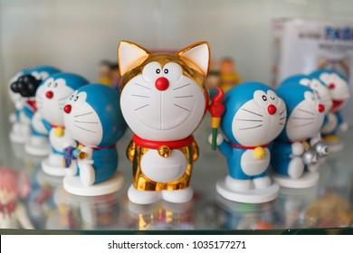 BANGKOK, THAILAND - 16 FEB 2018: Figures of Doraemon on store shelf. Doraemon is a Japanese manga series written and illustrated by Fujiko F. Fujio.
