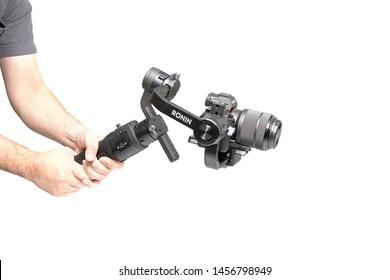 """Bangkok, Thailand - 16 July 2019: Mirrorless Sony """"Alpha 7 mark 3"""" and lens Sony FE 28-70 mm on the gimbal DJI Ronin-S."""