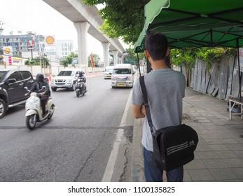 BANGKOK THAILAND - 16 May 2018 : The man wait the bus at bus stop.