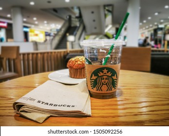 Bangkok, Thailand, 16/9/2019 Coffee and snacks are on the table and eat at Starbucks. Is a coffee shop from America in Seattle, Washington in 1971 by Gordon Boker, Jerry Baldwin and Sif Seagull.