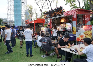 BANGKOK, THAILAND - 17 Aug, 2016: People joined many foodtrucks in the container garden, they happy to buy food and drink then waiting to meet friends, This event near to RCA.