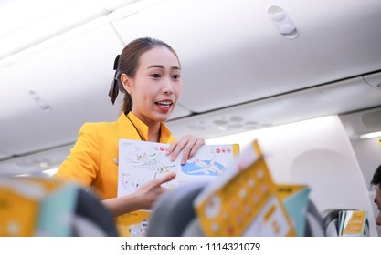 Bangkok, Thailand, 17 June 2018 Air hostess demonstrate safety procedures to passengers prior to flight take off.    Explain the usage. Safety equipment To the passengers on the plane.Blur softfocus.
