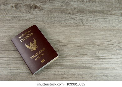 Bangkok, Thailand - 18 JANUARY 2018 - Thailand passport on wooden background.