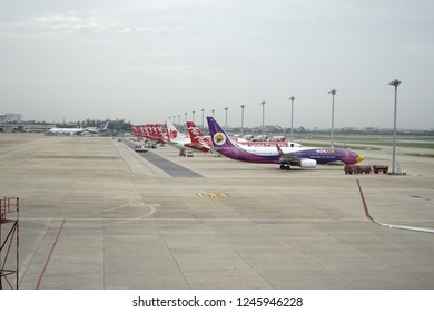 Bangkok / Thailand - 18 Jul, 2017: Bangkok/ Thailand - 18 Jul, 2017: View from waiting room at Don Mueng Airport, Thailand. There are many low cost airplanes waiting at the hangar for landing.