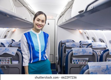 Bangkok Thailand 18 jun 2017 : Cabin crew in Blue uniform of  Bangkok airways was standing in the aircraft entrance and welcome passenger to the aircraft.