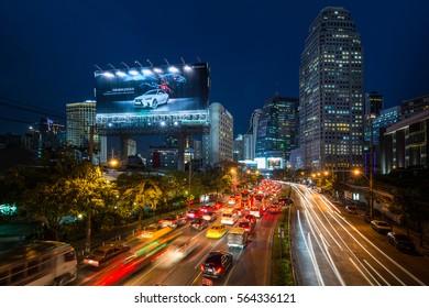 BANGKOK, THAILAND 18-JAN_2017: Traffic jam late afternoon of Asoke intersection where Sukhumvit Rd. cuts Ratchadaphisek Rd. during rush hours