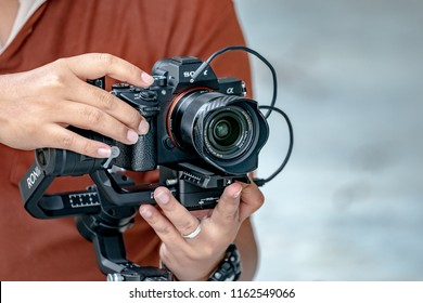 """Bangkok, Thailand - 19 Aug, 2018: Famous Camera; Sony """"A7iii"""" or """"Alpha 7 mark 3"""" and lens Sony FE 28mm f2.0 on the gimbal, """"Ronin S"""" are already launch in the Asia, Bangkok, Thailand."""