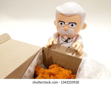 Bangkok Thailand. 19 Mar, 2019 : Colonel Harland Sanders statue doll with fried chicken.
