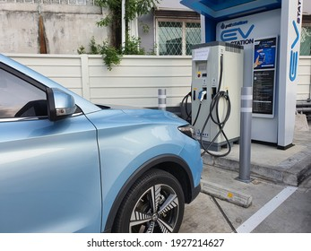 Bangkok, Thailand 1March2021: Photos of the parked blue MG ZS EV electric car. Electric charger at the charging cradle of the Ptt gas station.