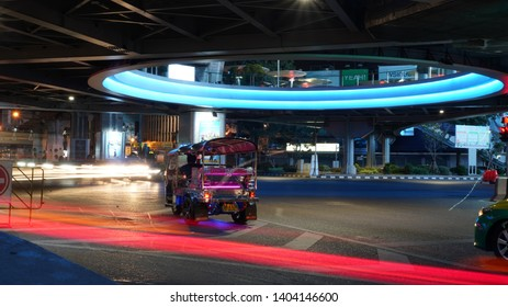 Bangkok Thailand. 2 feb 2019, skywalk pathumwan junction, Pathumwan Skywalk land mark shopping center, Bangkok night life road traffic with speed light car