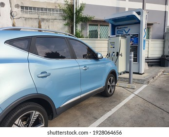Bangkok, Thailand 2 March 2021:The electric car is being charged at a special place for charging electric vehicles. A modern and eco-friendly mode of transport that has become widespread at Asia.
