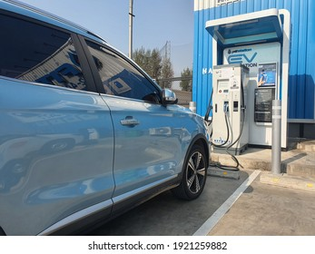 Bangkok, Thailand 20 February 2021: Photos of the parked blue MG ZS EV electric car.  Electric charger at the charging cradle of the Ptt gas station.