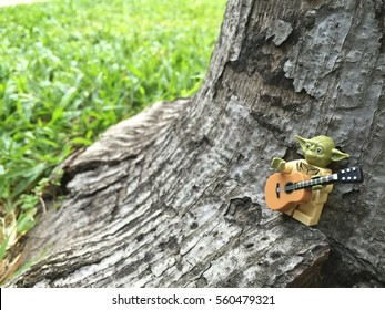 Bangkok, Thailand: 20 Jan 2017 - Lego Yoda playing guitar under the tree. This mini figure is from Star Wars sets. Lego is a brick brand by Lego group.