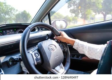 BANGKOK ,THAILAND - 20 JANUARY 2019: Woman driving Toyota Sienta car in enjoy holiday retirement life.