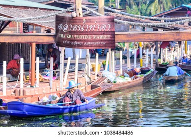 BANGKOK, THAILAND - 2015 December 27: Unidentified tourists and merchants on vintage boats at Tha Kha Floating Market in Samut Songkhram, Thailand.