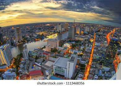 Bangkok, Thailand - 2015: Lebua and Sirocco bar at State Tower in Silom district during sunset.