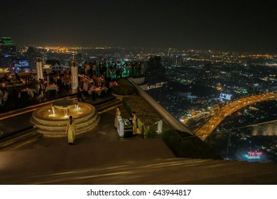 Bangkok, Thailand - 2017: Lebua and Sirocco bar at State Tower in Silom district at night. This bar was included in the Hangover movies,panoramic view from the sky bar at night over the city Bangkok